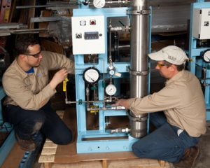 Two Titus Air Technicians fixing a machine