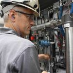 Titus company employee inspecting equipment