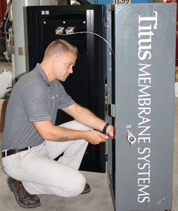 Employee working on a Titus Air System