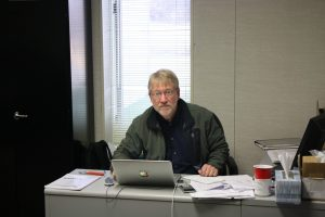 Bob Brown sitting at his desk