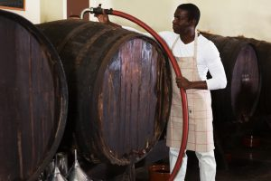 filtering wine in barrels